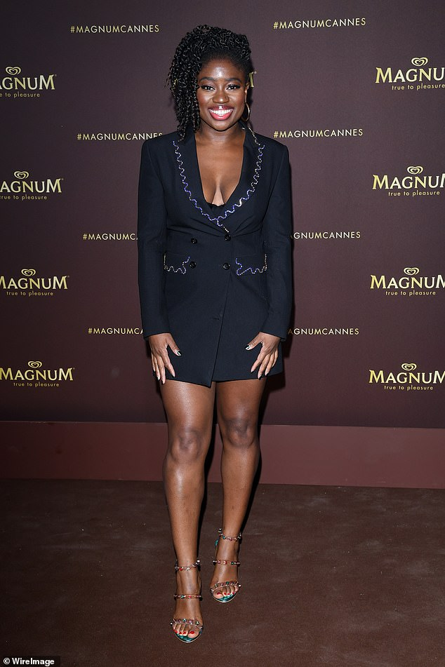 Stylish: Clara Amfo arrived in a plunging black blazer with silver detailing