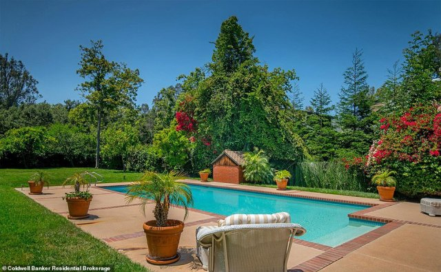 Nice place to be: The home Adele bought for her ex Simon boasts lavish interiors and a superstar-worthy pool (pictured)