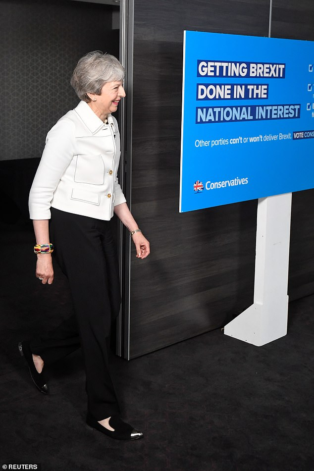 Mrs May is campaigning for the European elections in Bristol today (pictured) as the Brexit Party raced ahead and took aim at Nigel Farage