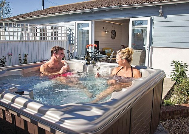 Francesca Brown said she couldn't wait for a soak in her Hoseasons 'VIP' cottage hot tub on the Isle of Wight. Pictured is a promotional shot of the property