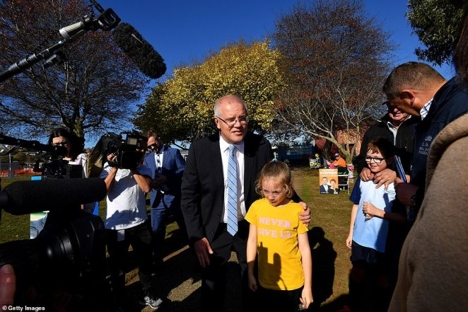 Prime Minister Scott Morrison talks to locals at Ulverstone Secondary College, 20 km west of Devonport