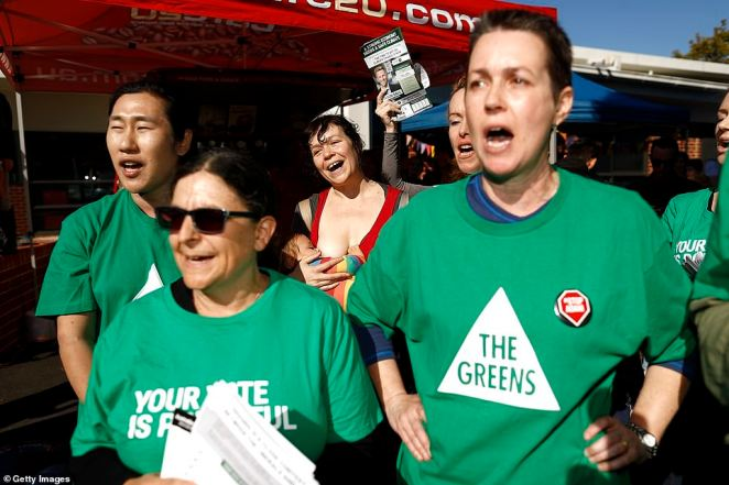 The Greens voters are seen as Bill Shorten visits Carnegie Primary School, in the seat of Higgins, Melbourne