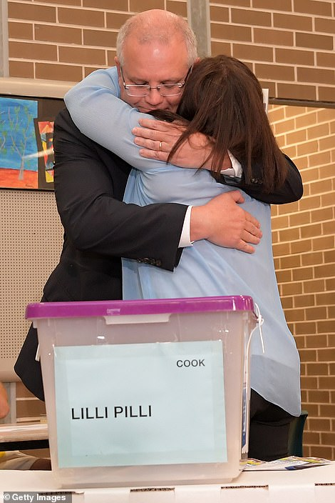 Mr Morrison kissed and hugged his wife after they cast their votes