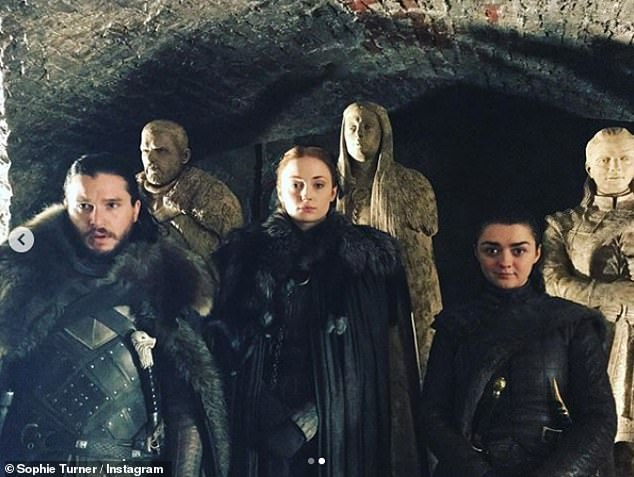 Who I am:Sophie went on to thank GOT and the 'people who make it' for making her the person 'I am today' (Pictured with Kit Harington as Jon Snow and Maisie Williams as Arya Stark)