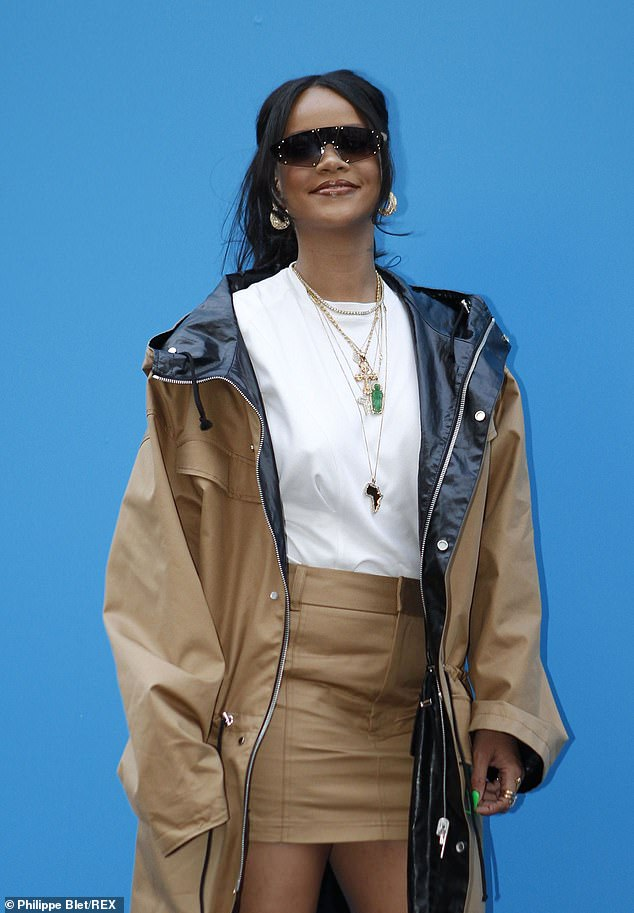 Paying attention to detail: The songstress accessorised the look with a group of gold embossed necklaces, chunky hoop earrings and diamante shades