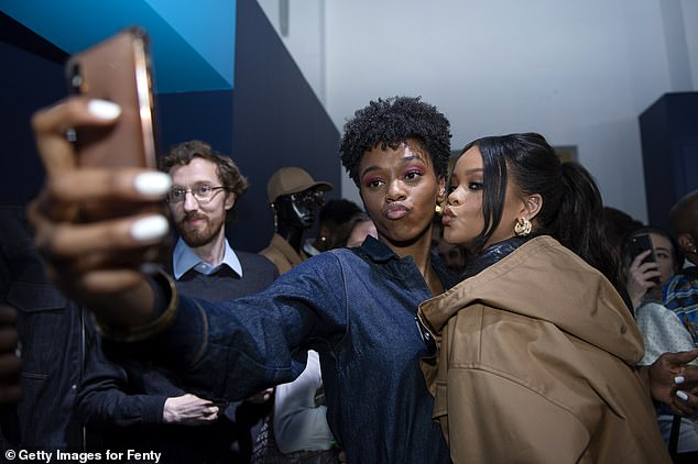 Strike a pose! Rihanna posed with fans at the fashion launch