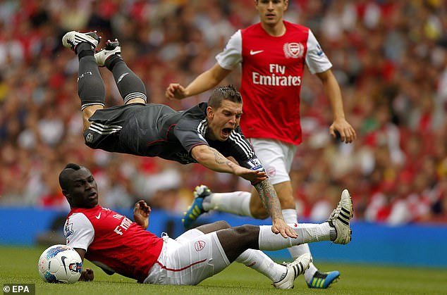 Emmanuel Frimpong (below) faces a big challenge for Liverpool's Daniel Agger during a Premier League game - but his career has deteriorated due to injury after a promising start