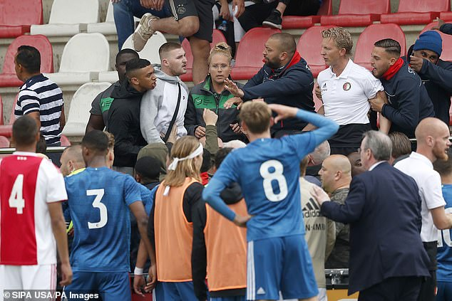 The Feyenoord coach was joined by security as violence occurred during the U19 encounter
