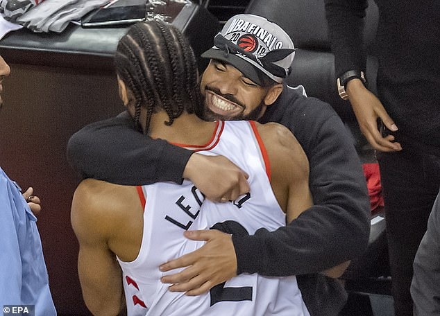 Rapper Drake was pictured hugging Raptors forward Leonard after Saturday's famous win