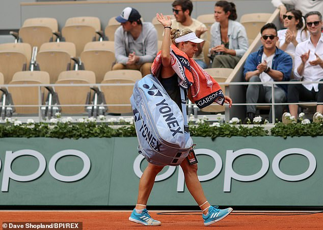 Angelique Kerber leaves the court dejected after her first round defeat in the French Open