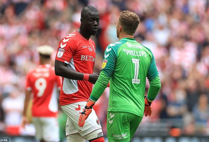 Sarr discusses the incident with Phillips as the Charlton players come to terms with the bizarre goal