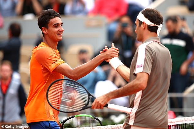 Federer shakes hands with Sonego after defeating him to reach the second round