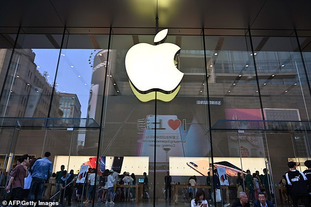 People visit an Apple store in Shanghai earlier this month. A new research note predicts that a total Chinese ban on iPhones could cut Apple's profits by 26 per cent in fiscal year 2020