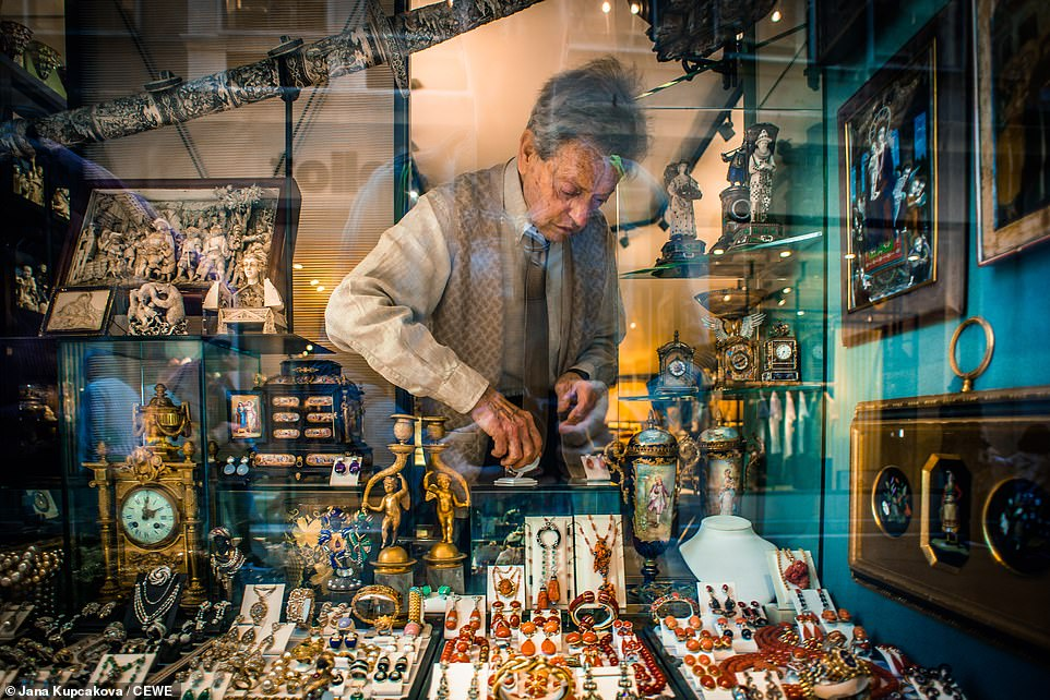 Czech photographerJana Kupcakova captured this colourful shot of an antique dealer adjusting his shop window while wandering around the historic streets of Venice.This shot was deemed a monthly winner for April
