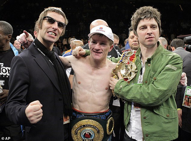 Ricky Hatton celebrates beating Paulie Malignaggi with Liam Gallagher (L) and Noel Gallagher