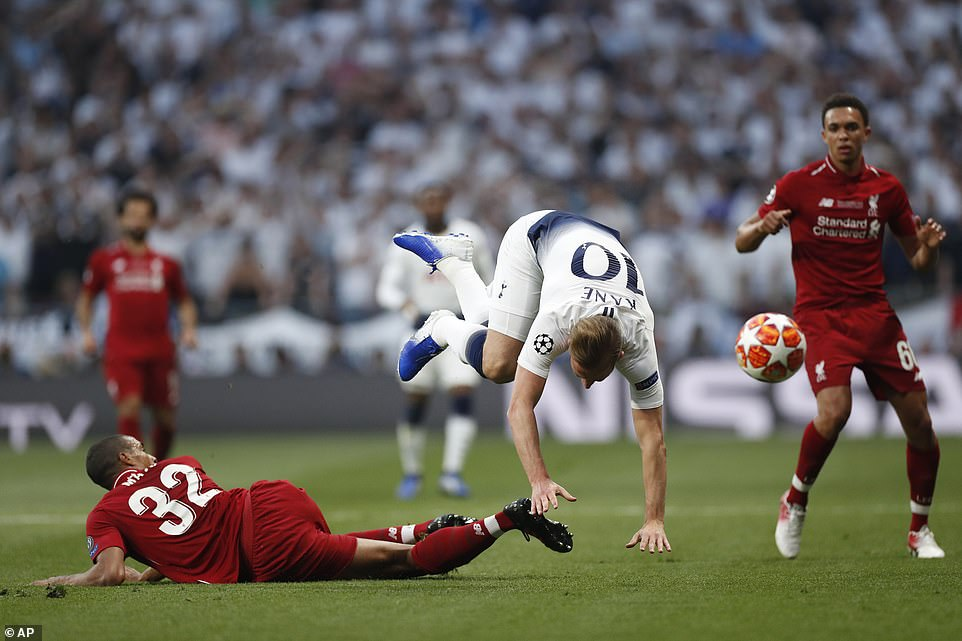 Joel Matip lunges into a challenge on England captain Harry Kane in the early stages of the Champions League final