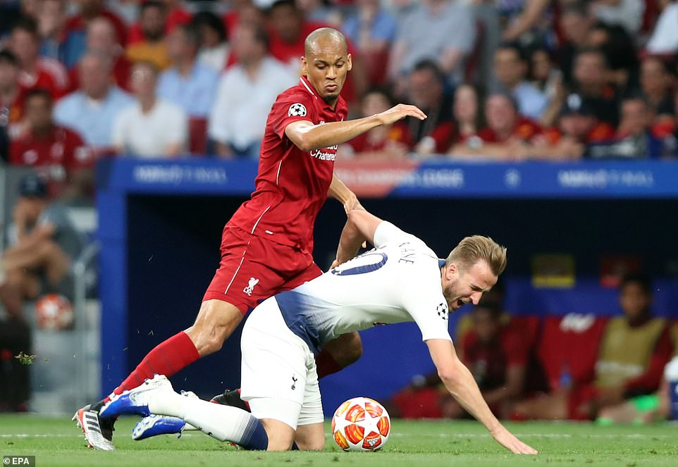Harry Kane goes to ground under pressure from Brazilian midfielder Fabinho who marshaled the Spurs threat well early on