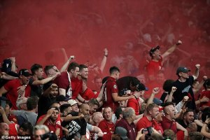A red flare was lit in the Liverpool end after Divock Origi sealed a 2-0 victory in Madrid