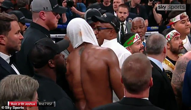 Joshua had to restrain his father from confronting Eddie Hearn in the ring after the fight