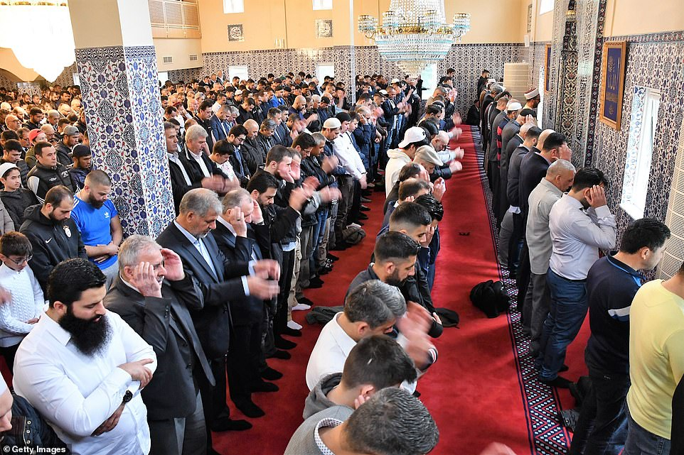 Muslims perform Eid al-Fitr prayers at Fittja Mosque in Stockholm, Sweden, early on Tuesday