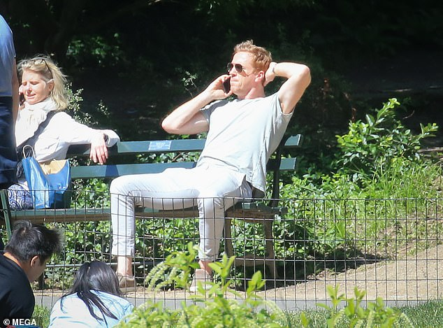 Kicking back: The Forsyte Saga actor looked typically hunky for his day in the sun, clad in a white tee, fawn jacket and stonewash skinny jeans