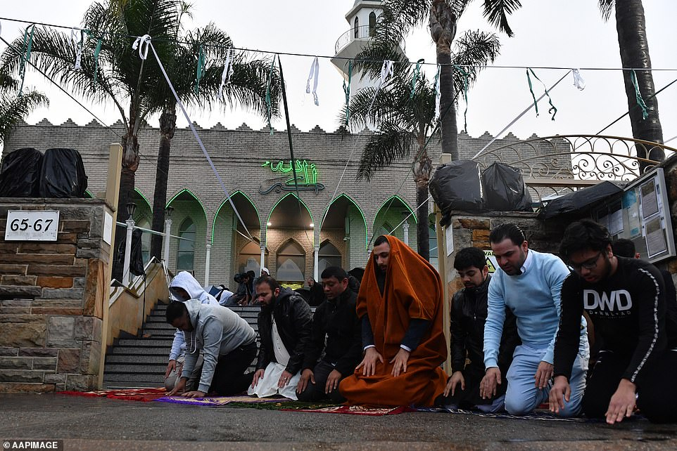The men braved the rain on Wednesday to give the traditional prayer of thanks to signify the completion of Ramadan