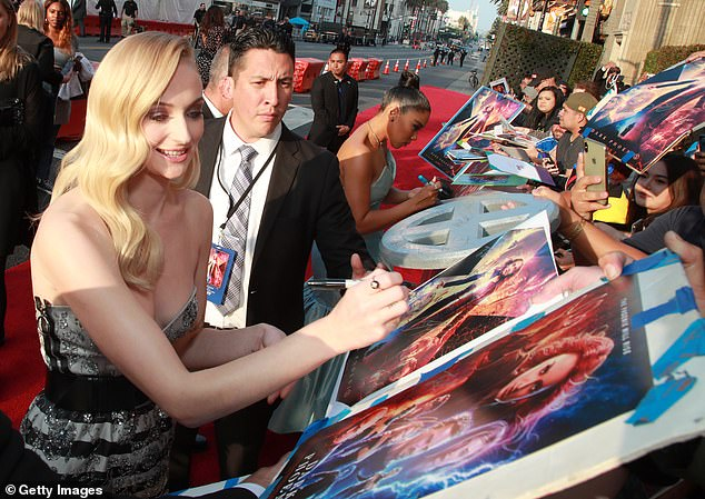 Making her mark: She has snapped up her fans for her best X-Men costumes, and stopped for sign posters and memorabilia