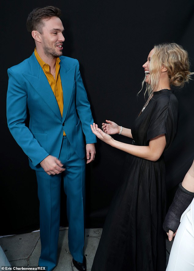 Best buds: Jennifer shared a laugh with her former boyfriend and co-star Nicholas Hoult