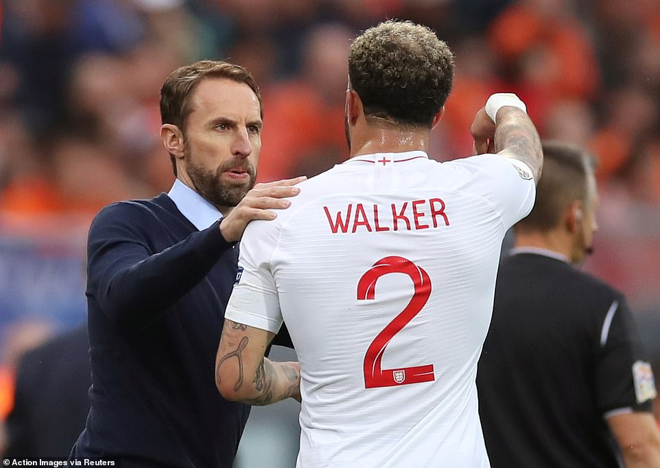 England manager Gareth Southgate gives instructions to right-back Kyle Walker during a break in play