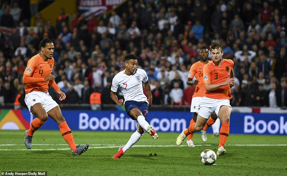 Second-half substitute Jesse Lingard (centre) slots the ball past Cillessen to score for England late on