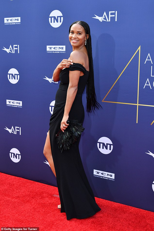 Classic: Joy Bryant put on a head-turning display in a chic and sophisticated black dress