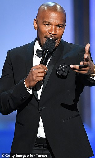 Showstopper! Jamie Foxx addressed the crowd while rocking a black suit