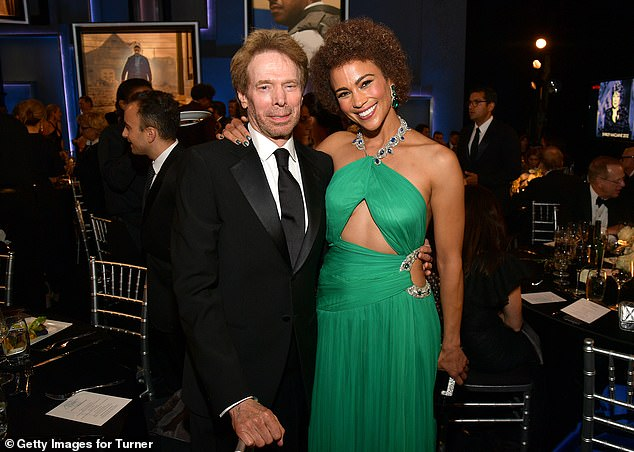 Mingling! Paula enjoyed a moment with Jerry Bruckheimer