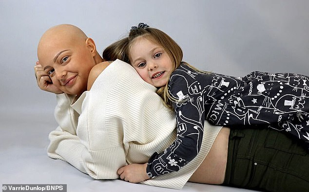 Pictured with her four-year-old daughter Lana, Miss Dunlop lost her hair due to chemotherapy