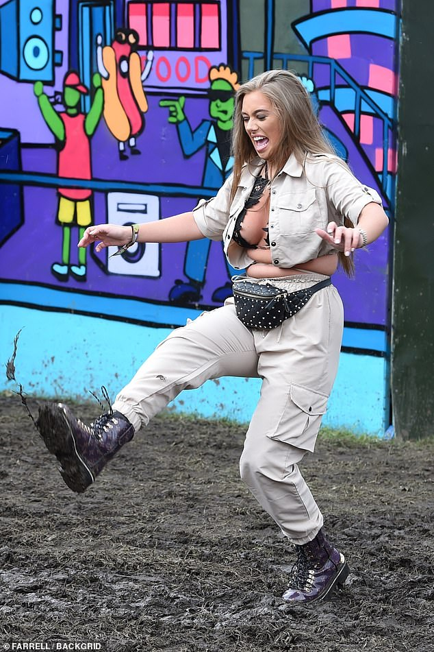 Rainy day:The Love Island starlet, who appeared in the third series of the ITV2 show, completed her look with chunky, lace-up boots and a black studded waist bag