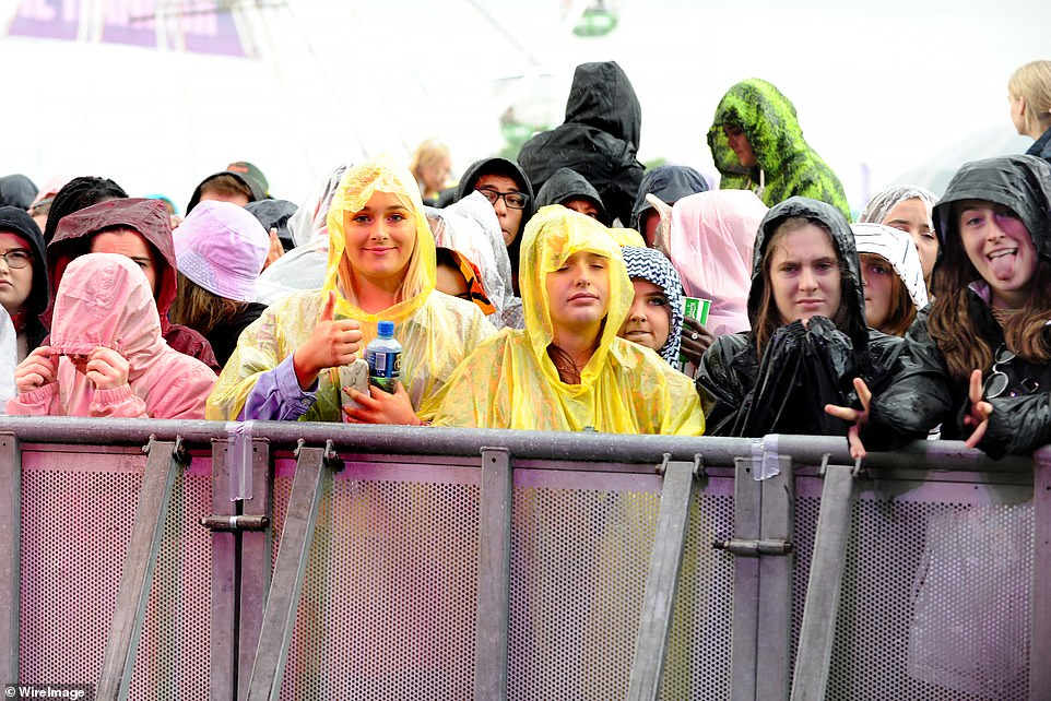 Festival-goers wait by the stage as the second day of the Parklife Festival commences in Manchester, The sightings comes as Britain continues to be buffeted by turbulent weather from the storm