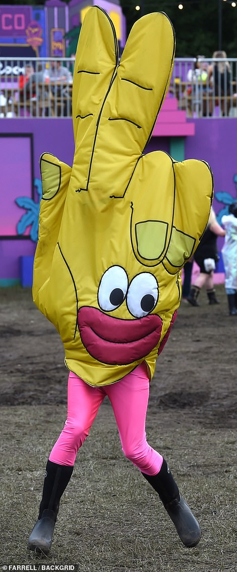 A festival-goer wears fancy dress as they take to the Manchester park