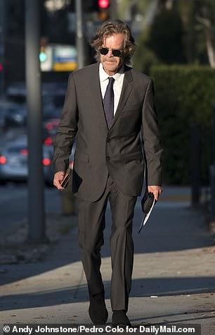 William H. Macy walks on a sidewalk near the venue in California