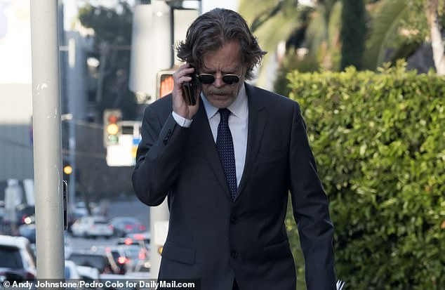 Need to talk: Macy speaks on his cell phone near the Dolby Theatre in Hollywood. Insiders have said that the parents are 'coming to terms with their situation and are dedicated to picking up the pieces' amid the college admissions scandal