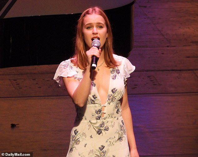 In full voice: After changing into a floral dress Sophia was given a microphone to sing with an ensemble as part of the graduation ceremony in Hollywood