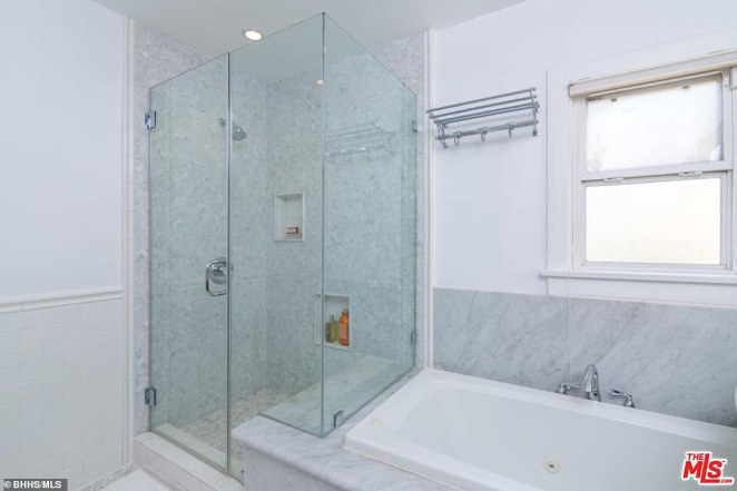Bathroom: This is one of three in the $2.4million property, with a bathtub and a large, glass-paneled shower area
