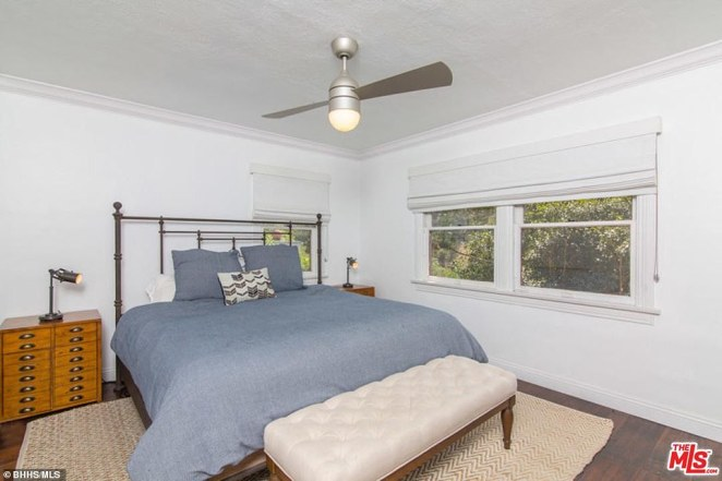Bedroom: This is one of three places to sleep in the property, which the Israeli TV producer has put on the market six years after he bought it. In this image there is a large double bed next to windows overlooking trees