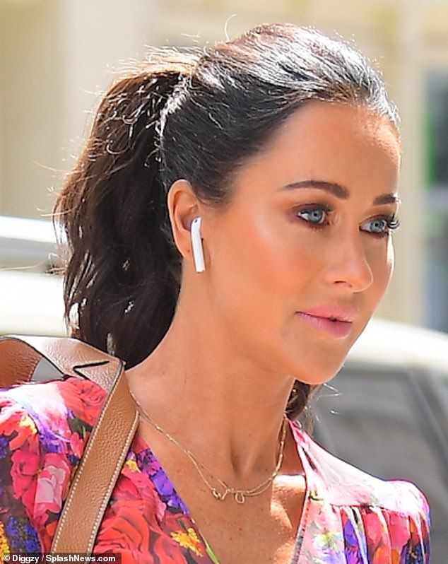 Beauty: The fashion stylist accessorized the ensemble with dainty gold jewelry, and was seen wearing a pair of Apple AirPods as she headed to work