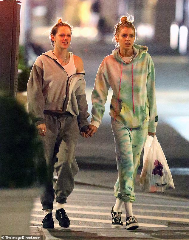 Back together: Kristen Stewart smiled as she walked hand-in-hand with on-again girlfriend Stella Maxwell in New York City on Monday night