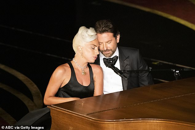 Historic performance: Rumors of a romance between Gaga and Bradley surged in February of this year after their steamy performance of their A Star Is Born tune Shallow at the Oscars; pictured on February 24 at the Oscars during their performance