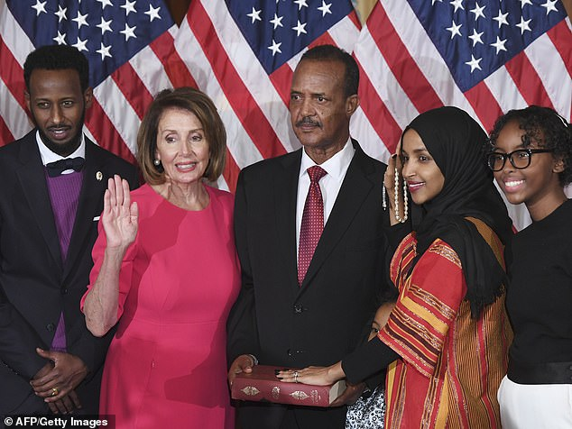 Speaker of the House Nancy Pelosi (D-CA), 2nd-L performs a ceremonial swearing-in for US House Representative Ilhan Omar (D-MN), 2nd-R at the start of the 116th Congress at the US Capitol in Washington, DC, January 3, 2019. At far left is Ahmed Abdisalan Hirsi