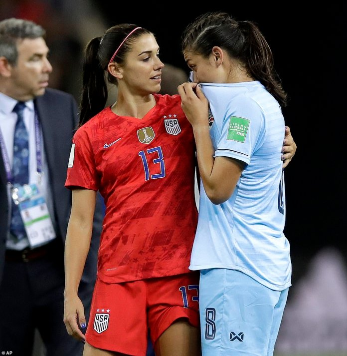 Morgan, left, comforts Thailand's Miranda Nild, right, who cried after thrashing in Riems on Tuesday night