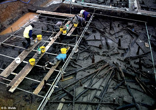 Archaeologists work on a scaffold platform assembled above Must Farm's 'structure 1'