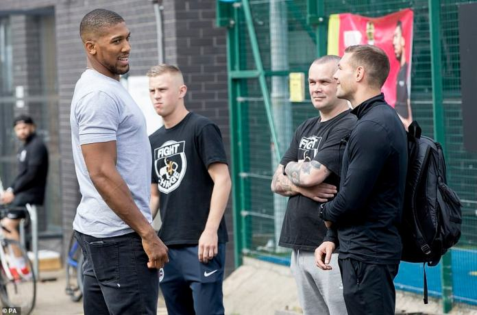 Anthony Joshua engaged in conversation ahead of the training session he is due to lead alongside boxing success Nicola Adams
