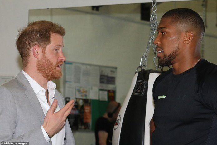 The Duke of Sussex speaks with British boxer Anthony Johnson during the launch of Made by Sport. He used animated hand gestures as they engaged in conversation